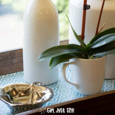Fast wooden tray updated with ironstone and an orchid on pretty contact paper.