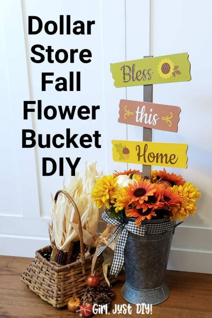 Dollar Store Fall flower bucket DIY on floor near white wall.