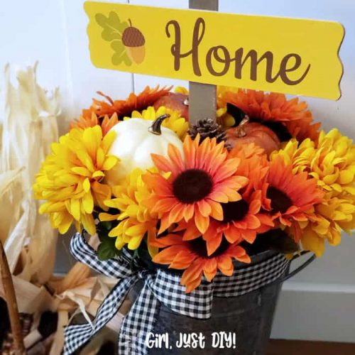 Fall flower bucket diy with gingham ribbon tied at top.