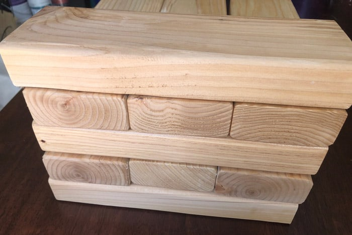 Closeup of stacked 2x4s for Giant Jenga game play.