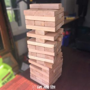 DIY Giant Jenga Game on table and play underway.