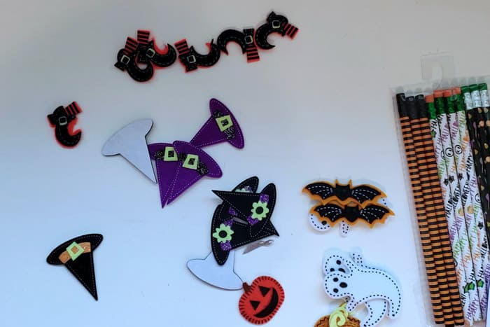 Halloween craft felt stickers on table with pencils preparing to make non-candy halloween treats.