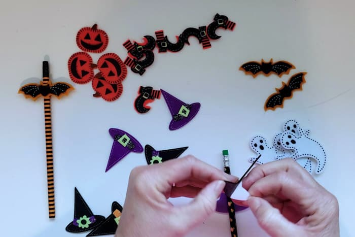 Peeling the back off of a felt halloween sticker.