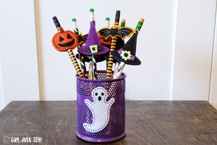 Pencil cup filled with non-candy Halloween treats for kids to give out on halloween night.