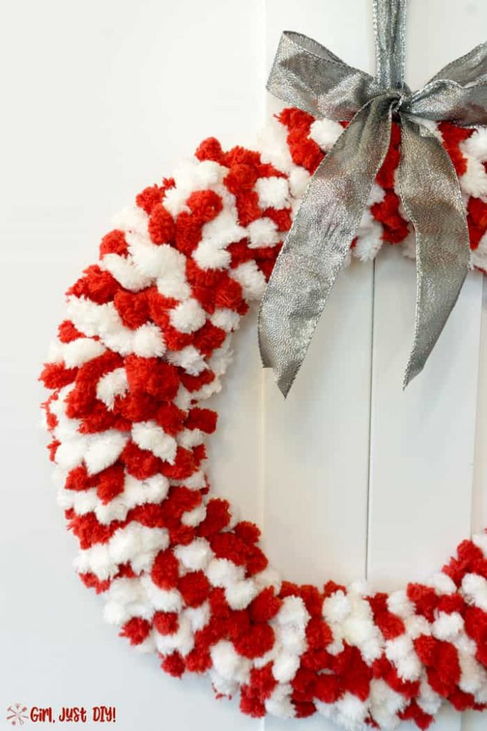 Simple but elegant Red and white fluffy christmas wreath with silver ribbon.