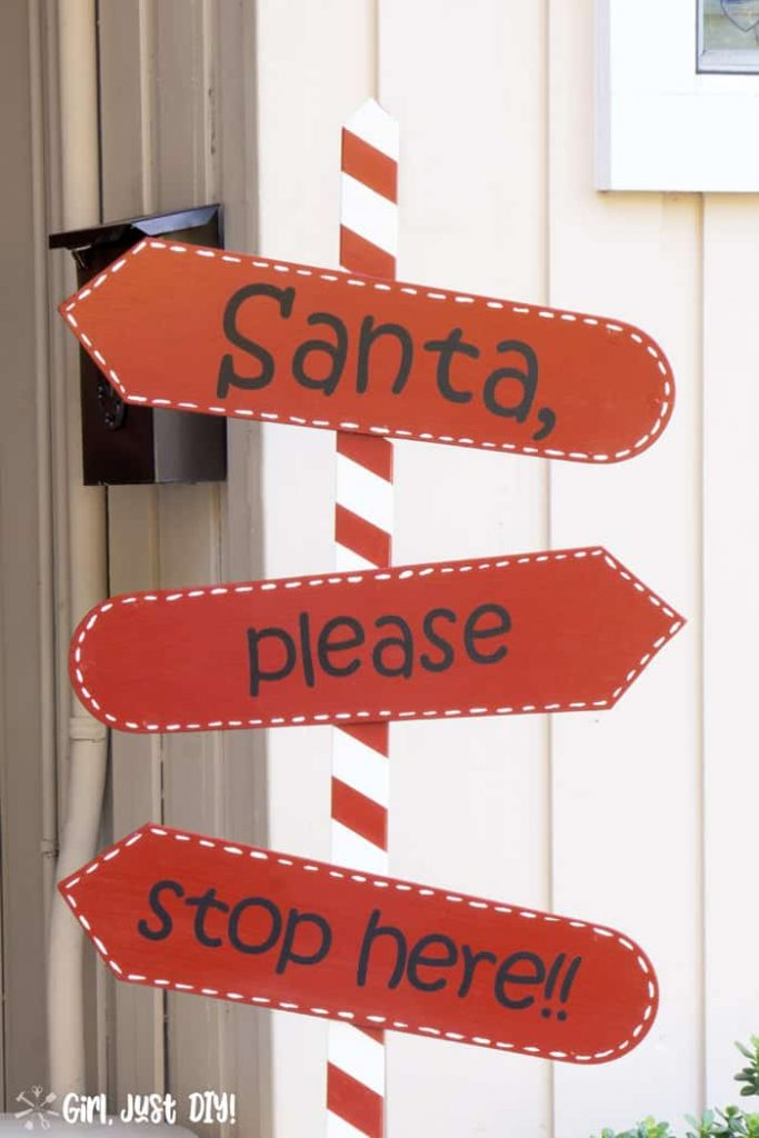 Santa stop here sign closeup showing white dashes around red fan blades.