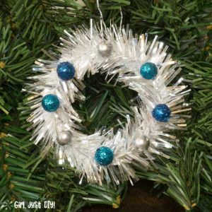 Single mini wreath ornament with blue berries closeup