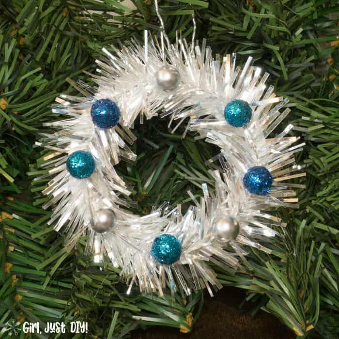 Single mini wreath ornament with blue berries closeup