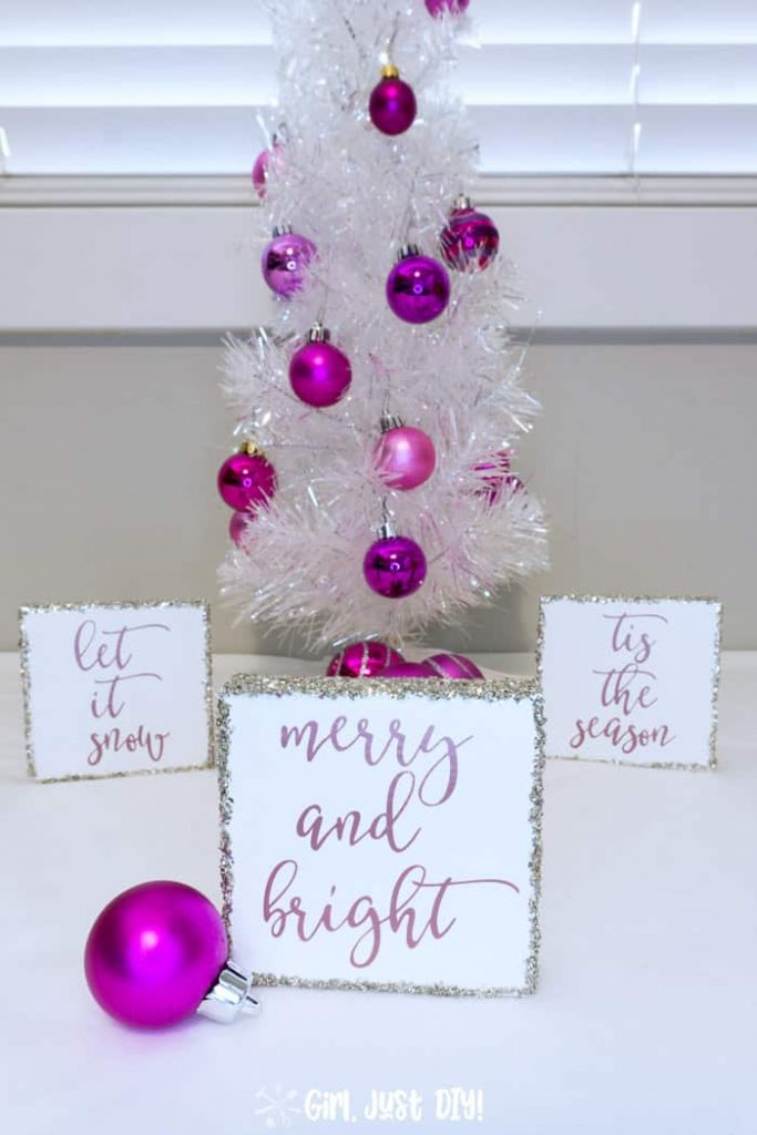 Merry and Bright Christmas Wood sign in front of two more by white Christmas tree.