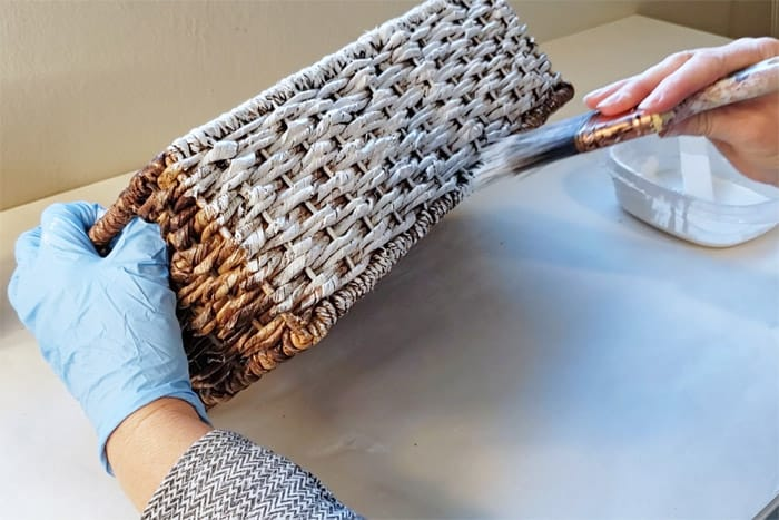 whitewashing the bottom of the wicker basket