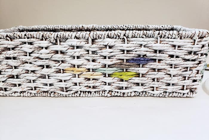 White painted basket with colorful paint swatches