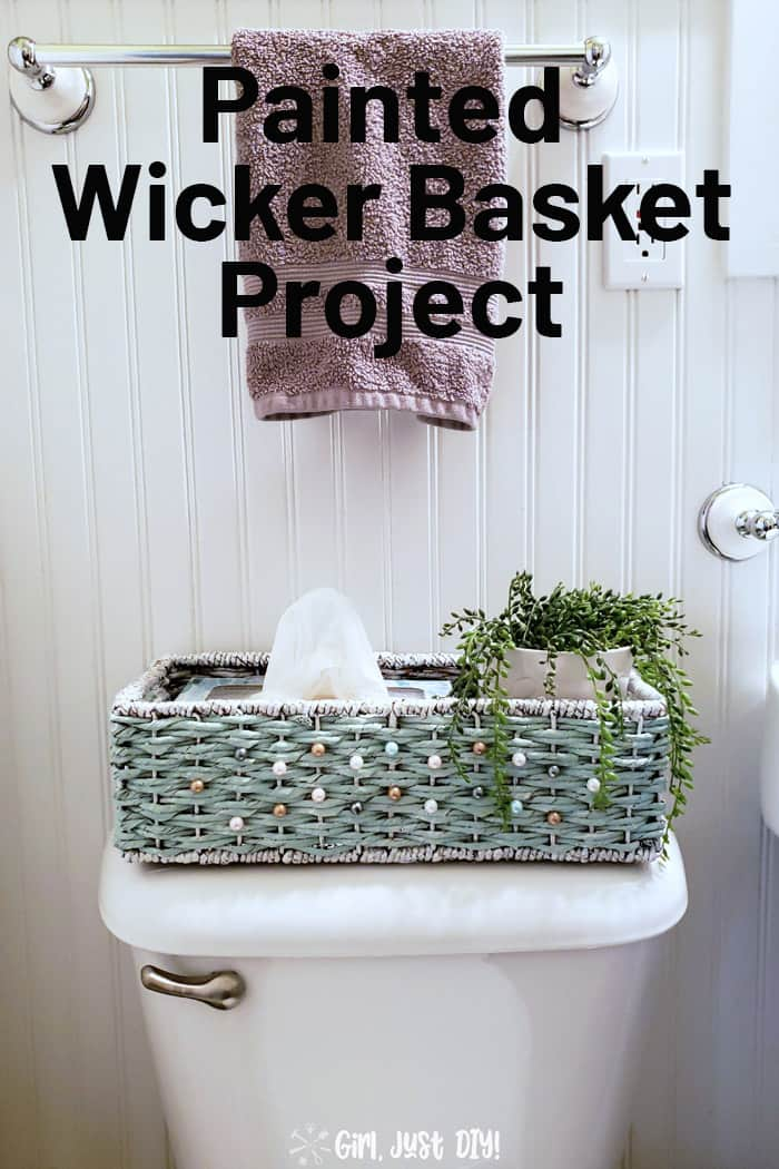 Updated and painted wicker basket on toilet with houseplant
