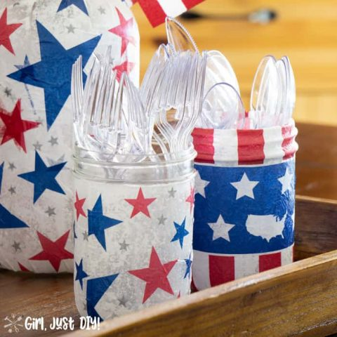 Closeup of 4th of July jars with plastic utensils