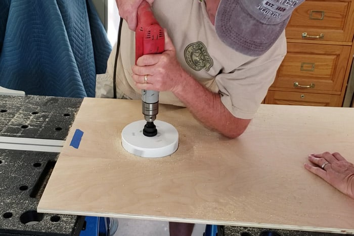 Using Drill and hole saw to make hole in 2x4 plywood sheet