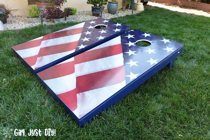 Cornhole board games on front lawn with american flag decal
