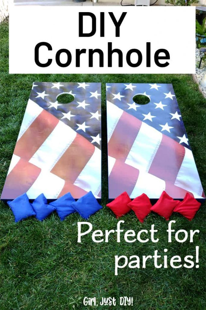 Cornhole boards on grass with game bags.