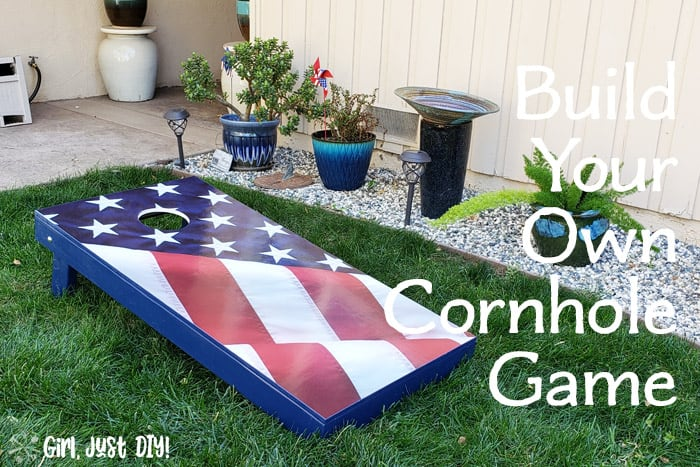 Cornhole board game next to fower bed with text overlay