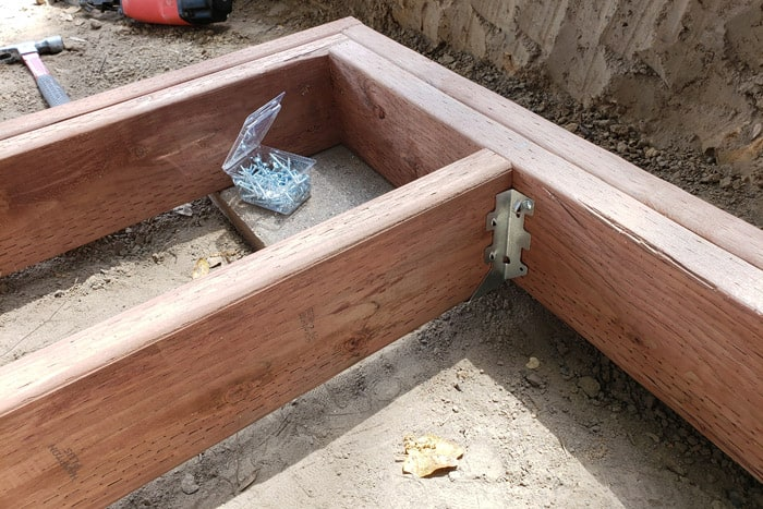 wooden frame with joists installed using joist hangers