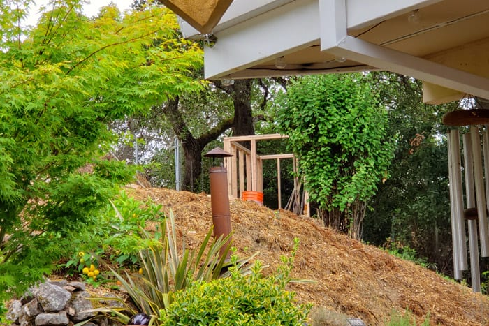 Framed shed visible from patio below