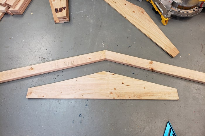2x4s cut as roof trusses with gusset