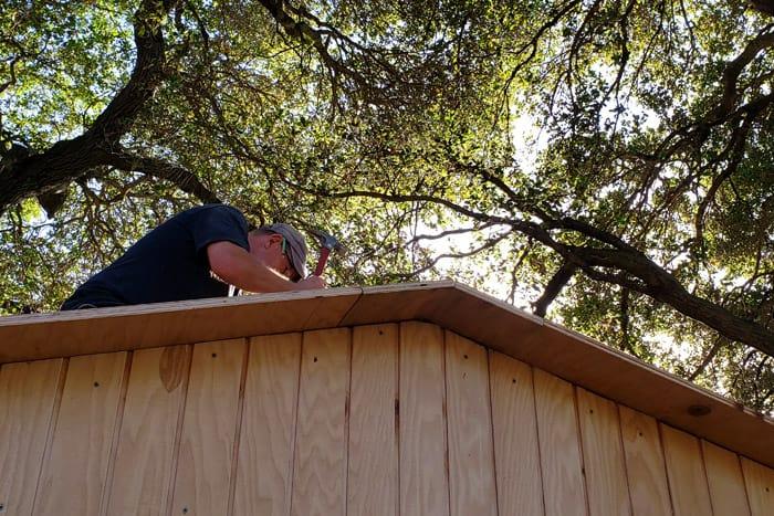 Underside view of roof sheathing overhang.