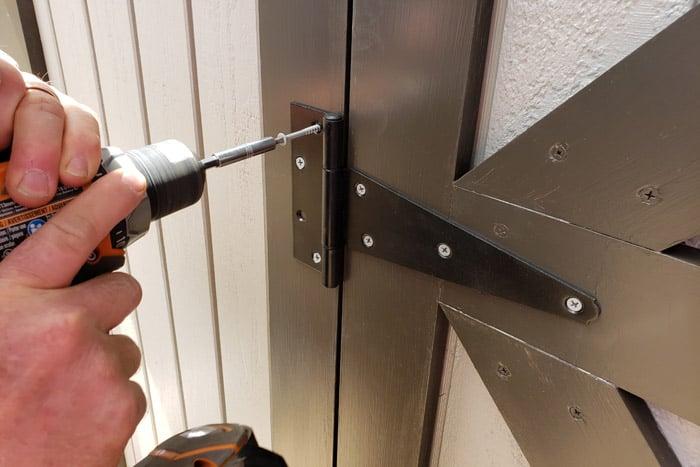 screwing shed door hinges to door frame trim