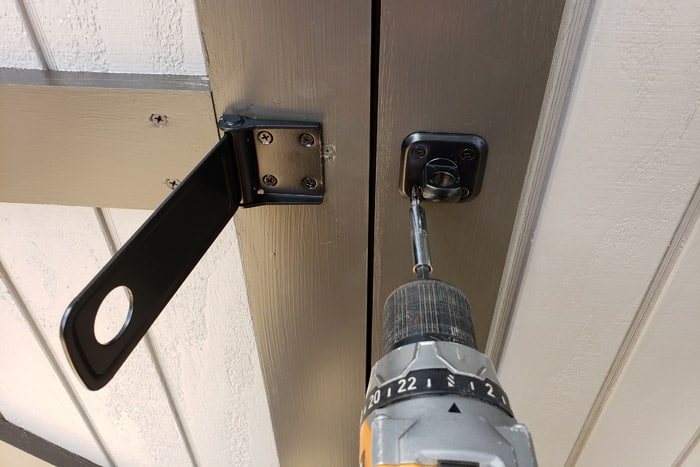 installing latch and lock to shed door with cordless drill