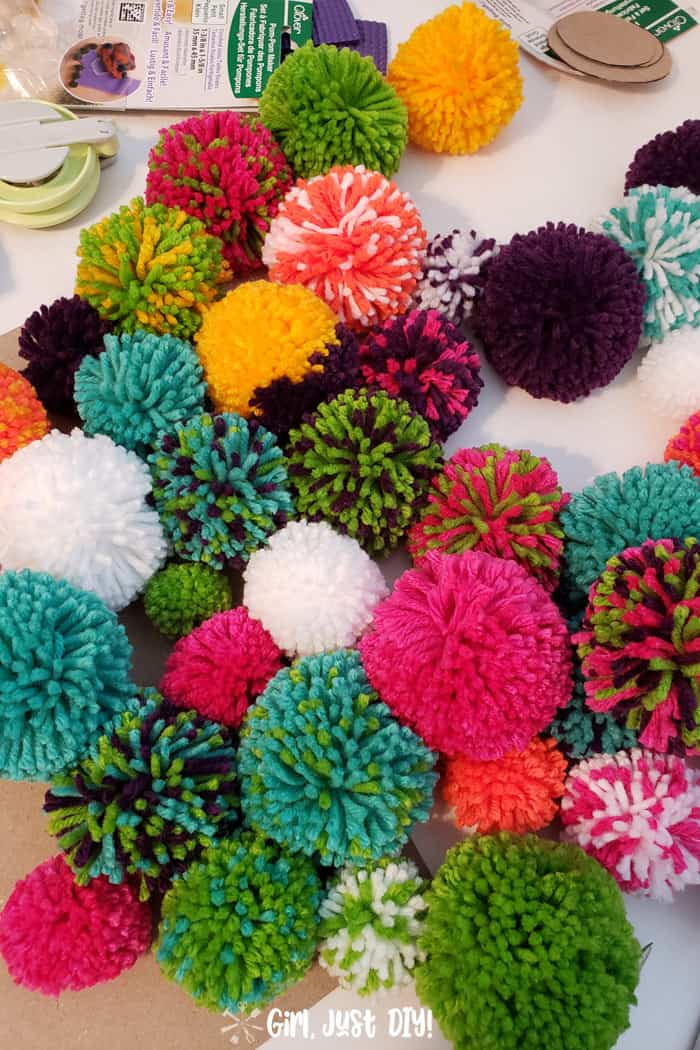 pile of colorful pompoms ready to make a wreath