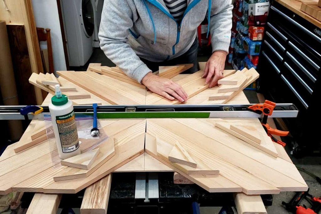 placing slats for diy mug rack against clamped level