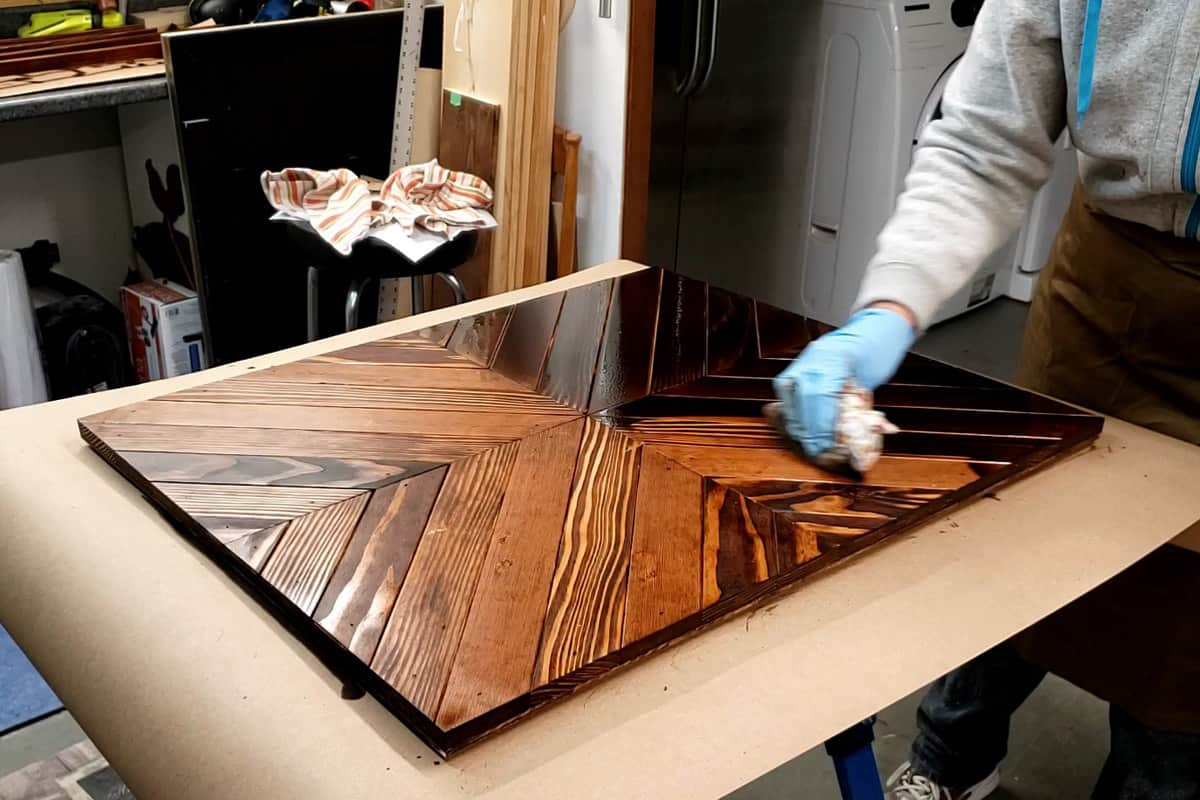 Staining raw wood using an old rag