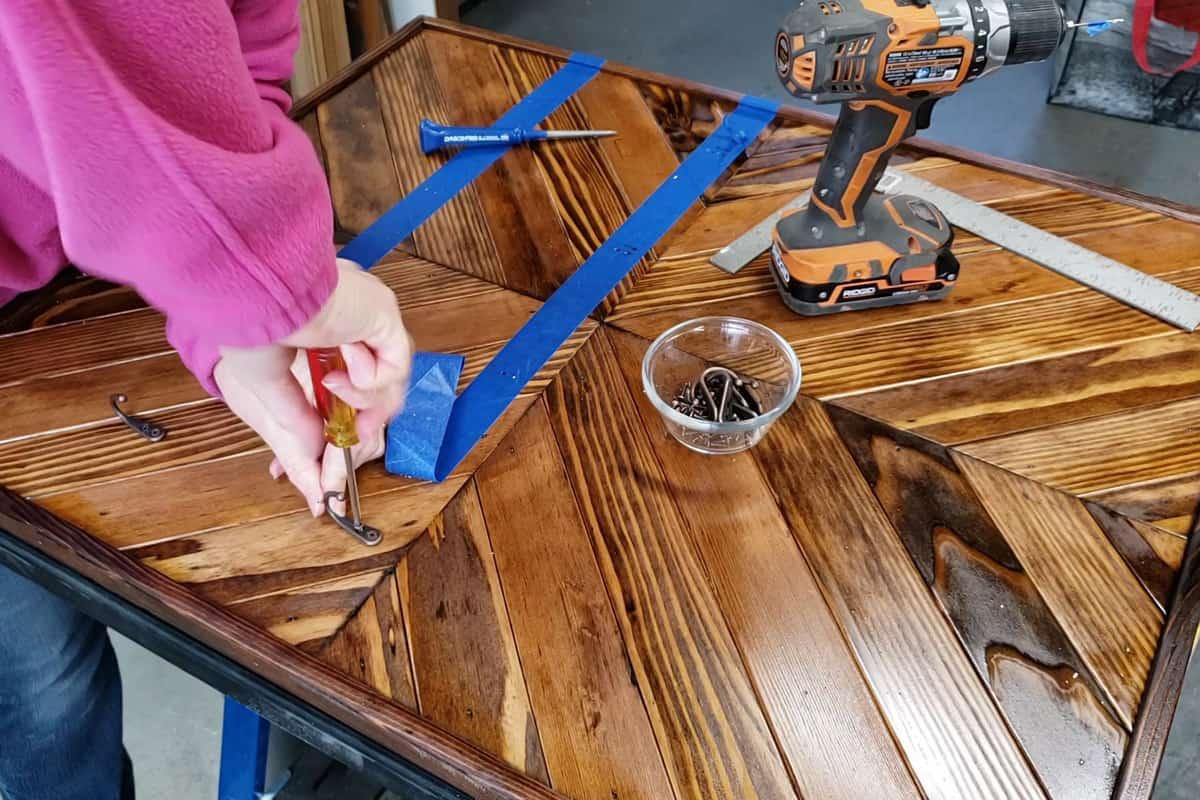 adding mug hooks to the wood rack