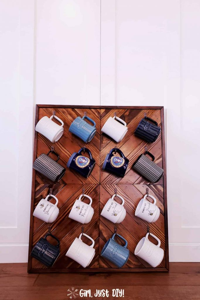 DIY Coffee Mug Rack fill with cups leaning against a wall.