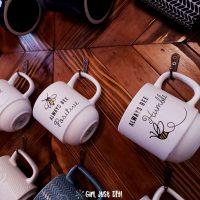 Closeup of coffee cups on mug rack