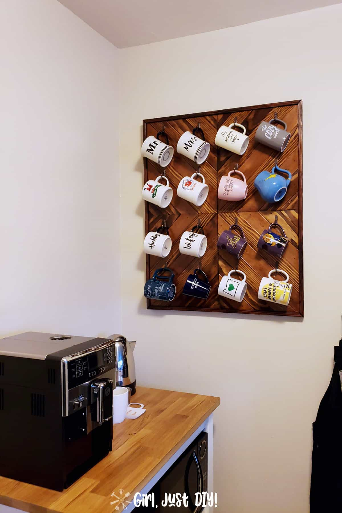 DIY Coffee Mug Rack hanging on wall in kitchen filled with coffee cups.